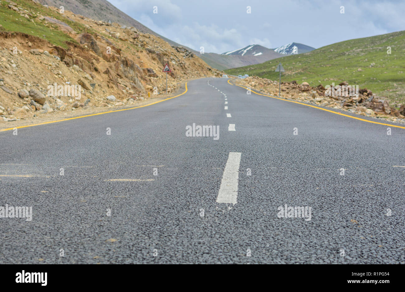 Alone on an empty highway - Stock Image