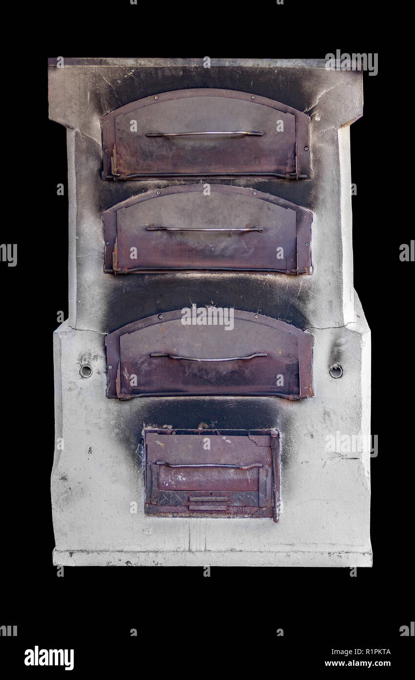 front side of a historic oven in black back - Stock Image
