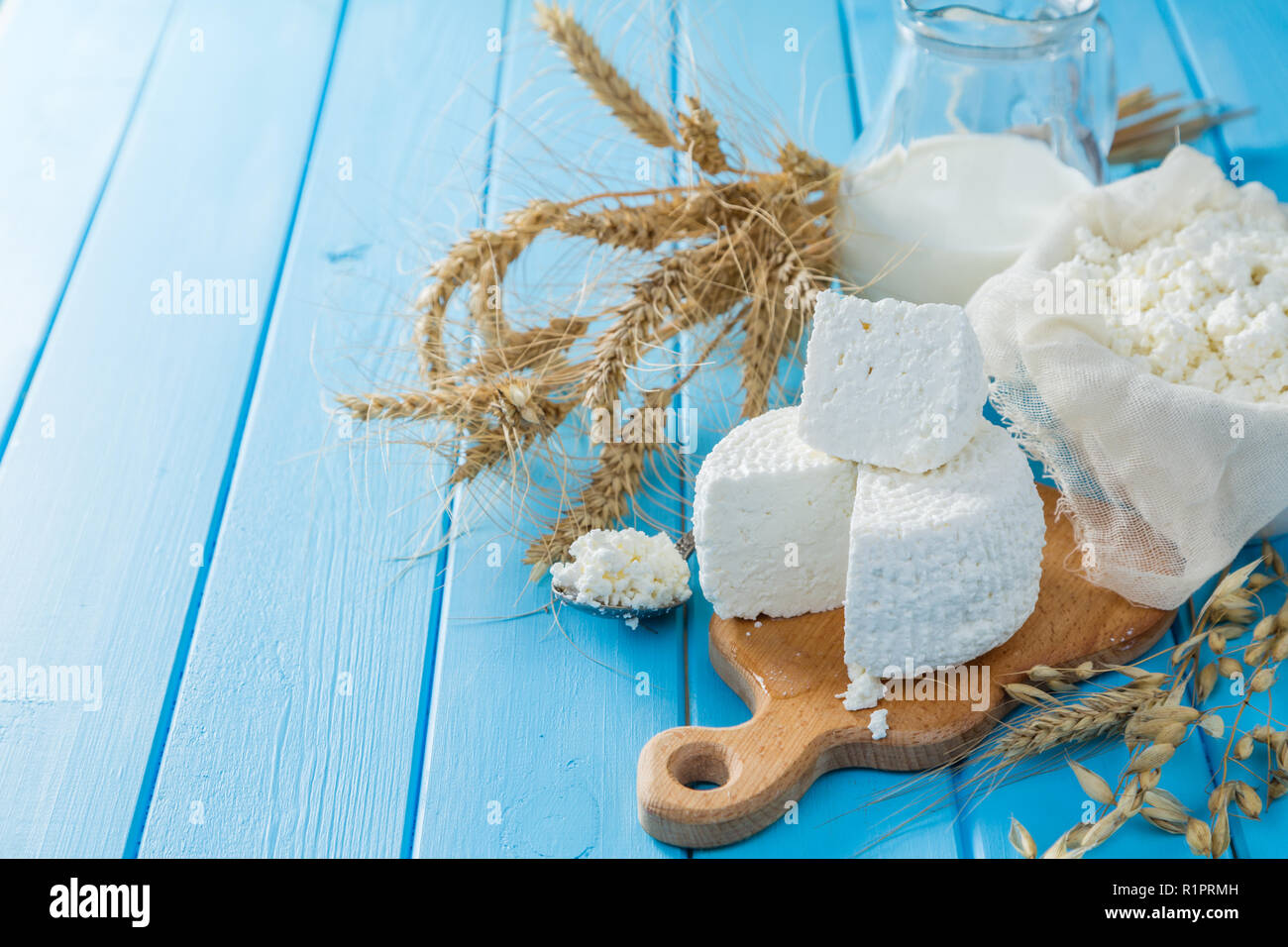 Selection of dairy products wood background, copy space - Stock Image