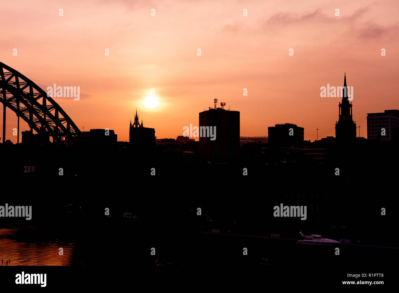 Newcastle upon Tyne/England - Tyne bridge and Newcastle skyline at sunset in silhouette Stock Photo