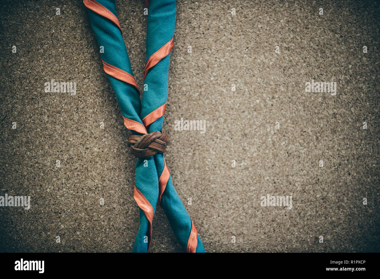 Orange,blue and yellow frame scout scarf. Concept is learning Scout subject. - Stock Image