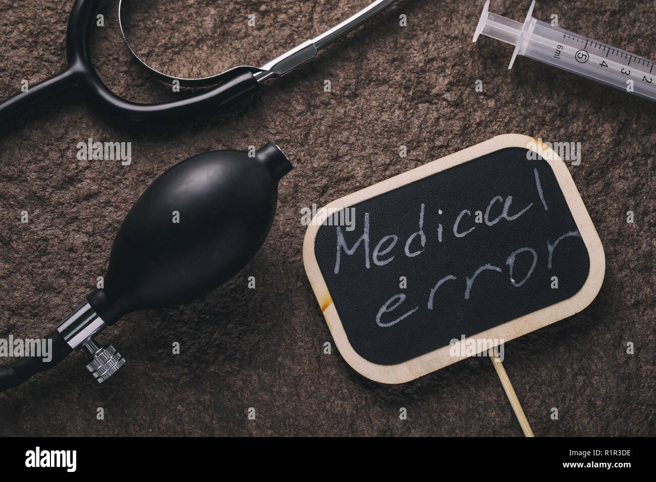 Medical instruments and medical error sign - Stock Image