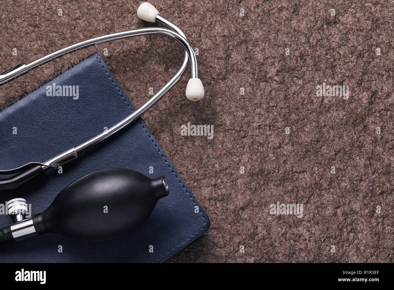 Medical instruments on a stone surface with copy space - Stock Image