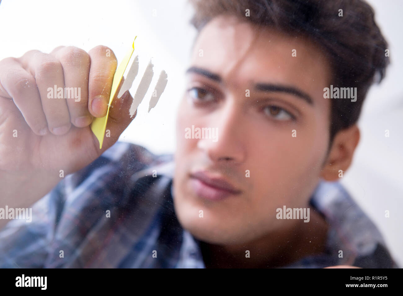 Drug addict sniffing cocaine narcotic Stock Photo: 224859017 - Alamy