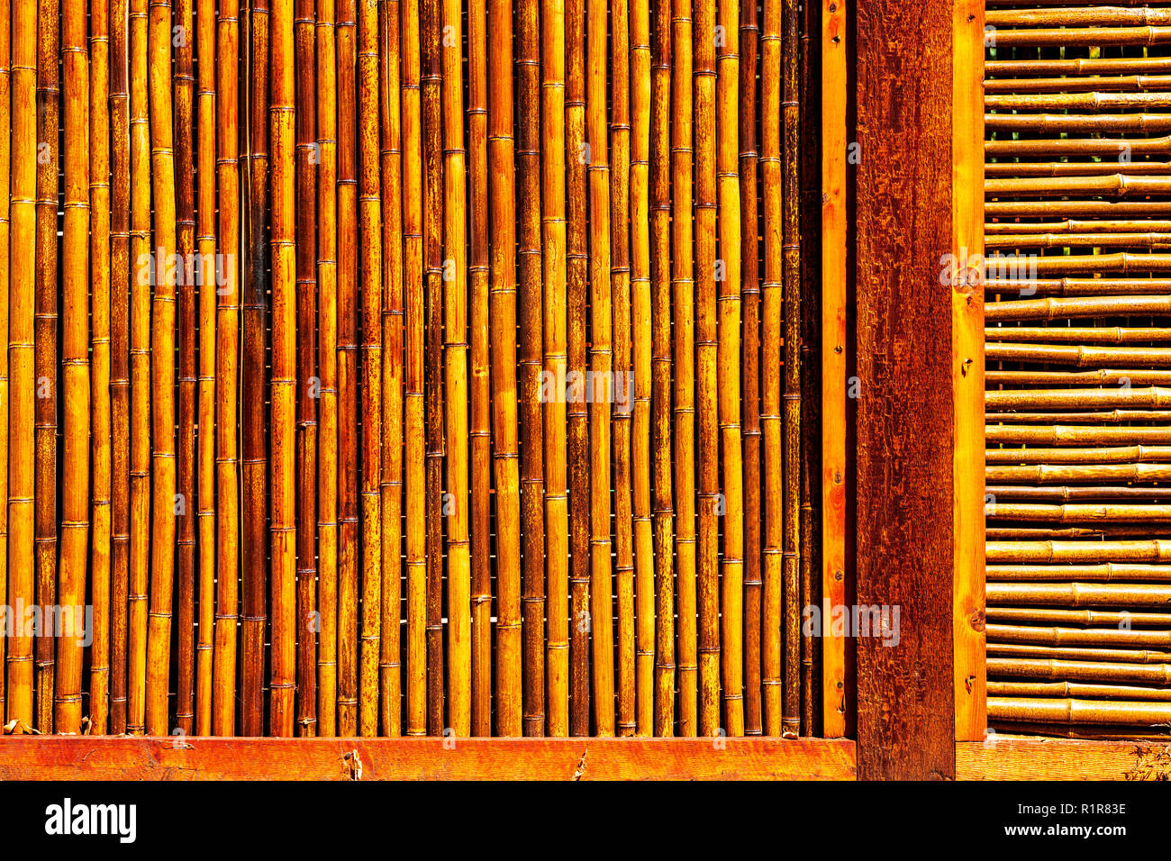 Bamboo fence creates graphic patterns Stock Photo