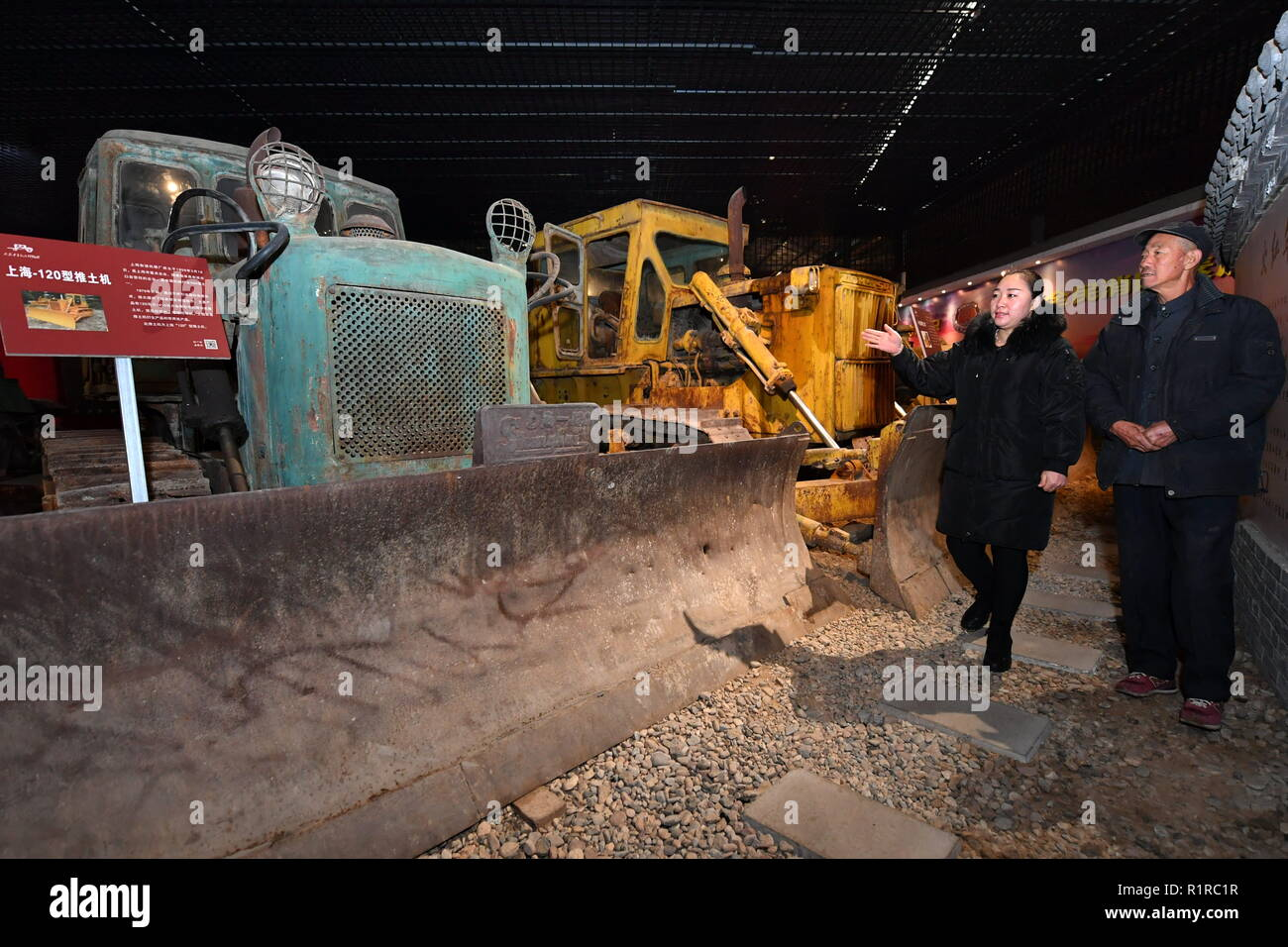 Taiyuan, China's Shanxi Province. 14th Nov, 2018. A narrator introduces bulldozers at a museum specialized in old vehicles in Taiyuan, capital of north China's Shanxi Province, Nov. 14, 2018. Nearly 400 old vehicles and bicycles are exhibited at the museum. Credit: Cao Yang/Xinhua/Alamy Live News - Stock Image
