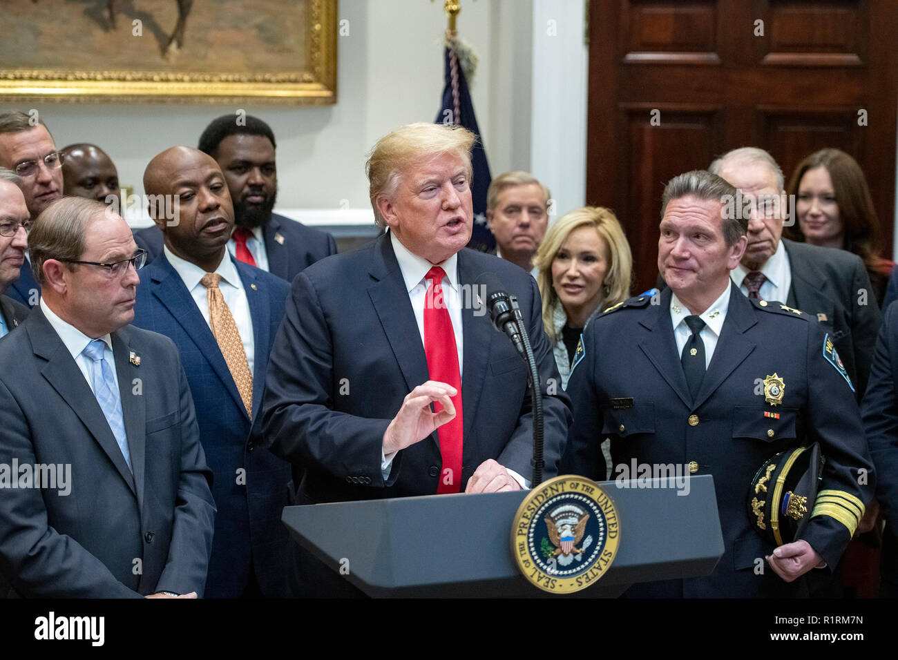 """United States President Donald J. Trump, center, announces his support of H. R. 5682, the """"First Step Act"""" in the Roosevelt Room of the White House in Washington, DC on Wednesday, November 14, 2018. According to the website congress.gov, this bill is titled """"the Formerly Incarcerated Reenter Society Transformed Safely Transitioning Every Person Act or the FIRST STEP Act."""" It enjoys bipartisan support. Standing with the President are: Chuck Canterbury, National President, Fraternal Order of Police, left, and Chief Paul Cell, President, International Association of Chiefs of Police, right. Cr Stock Photo"""