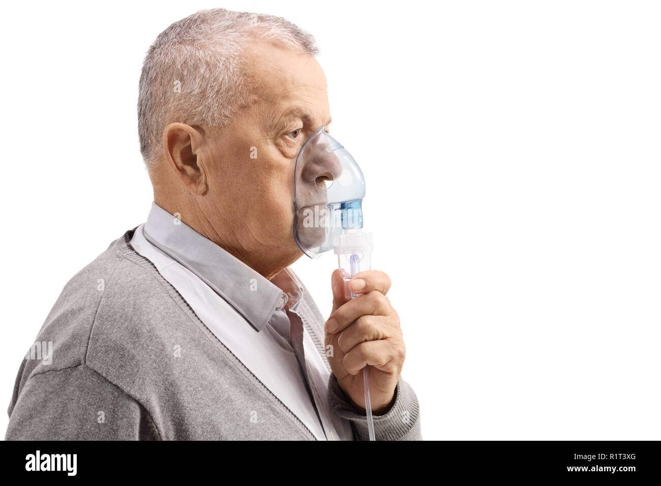 Mature man using an inhaler isolated on white background - Stock Image