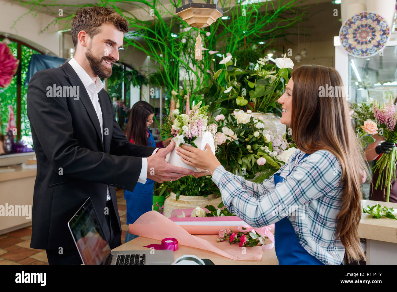 Man bought bouquet - Stock Image