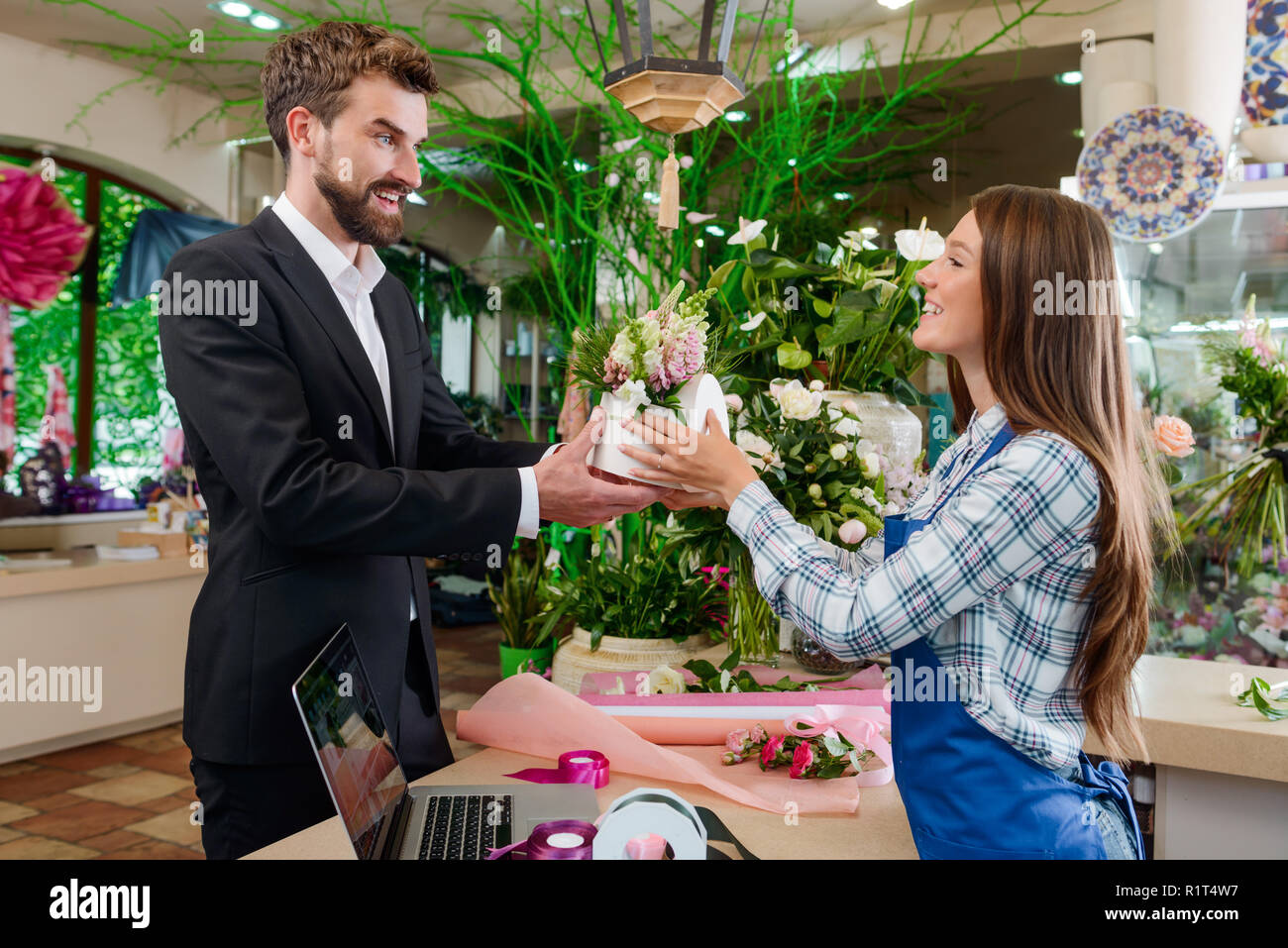 Happy man bought flowers - Stock Image
