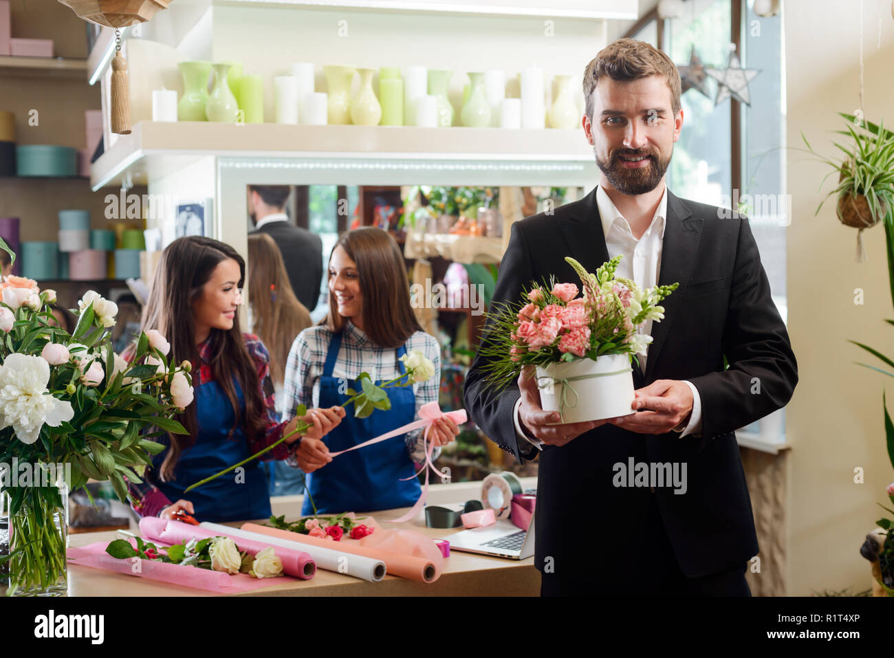 Hansome man bought flowers - Stock Image