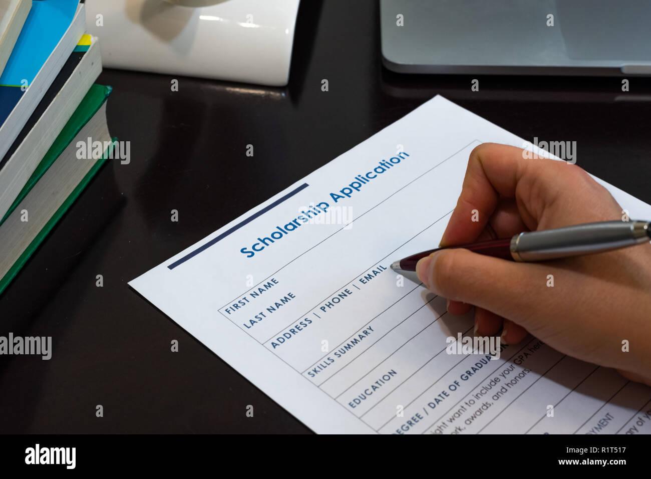Filling scholarship application form graduate student education funding - Stock Image