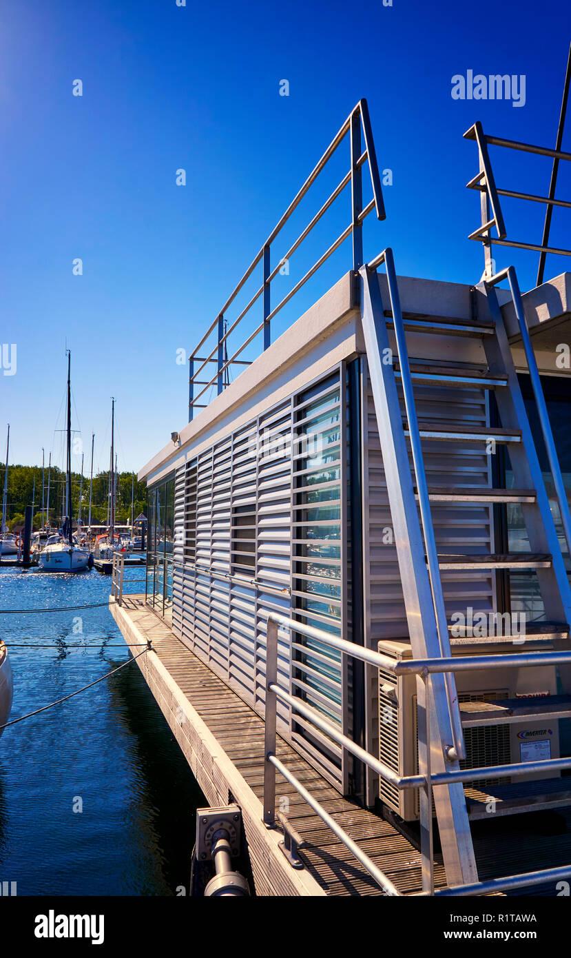 Modern houseboat in the harbor Weiße Wiek Boltenhagen. Germany - Stock Image