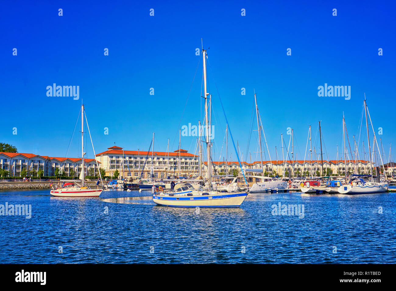 Holiday resort with sailboats in the harbor Weiße Wiek. - Stock Image