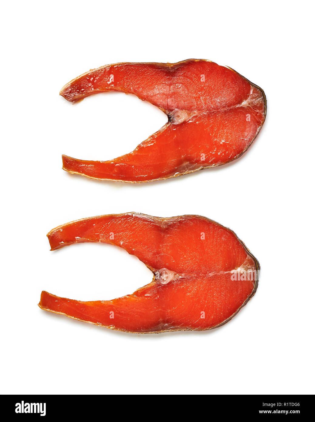 Slices of smoked red salmon isolated on white background. Top view. - Stock Image
