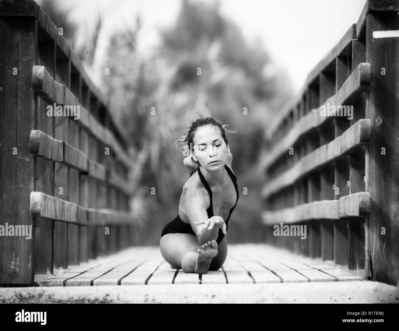 young woman doing yoga in a beautifull place,  photos in bnw - Stock Image