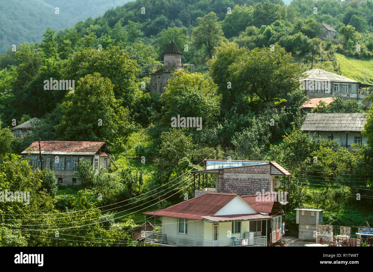 Dilijan, Armenia, August 24, 2018:View of the mountains covered with forest and the chapel of St. Sarkis in the village of gosh, located near the town Stock Photo