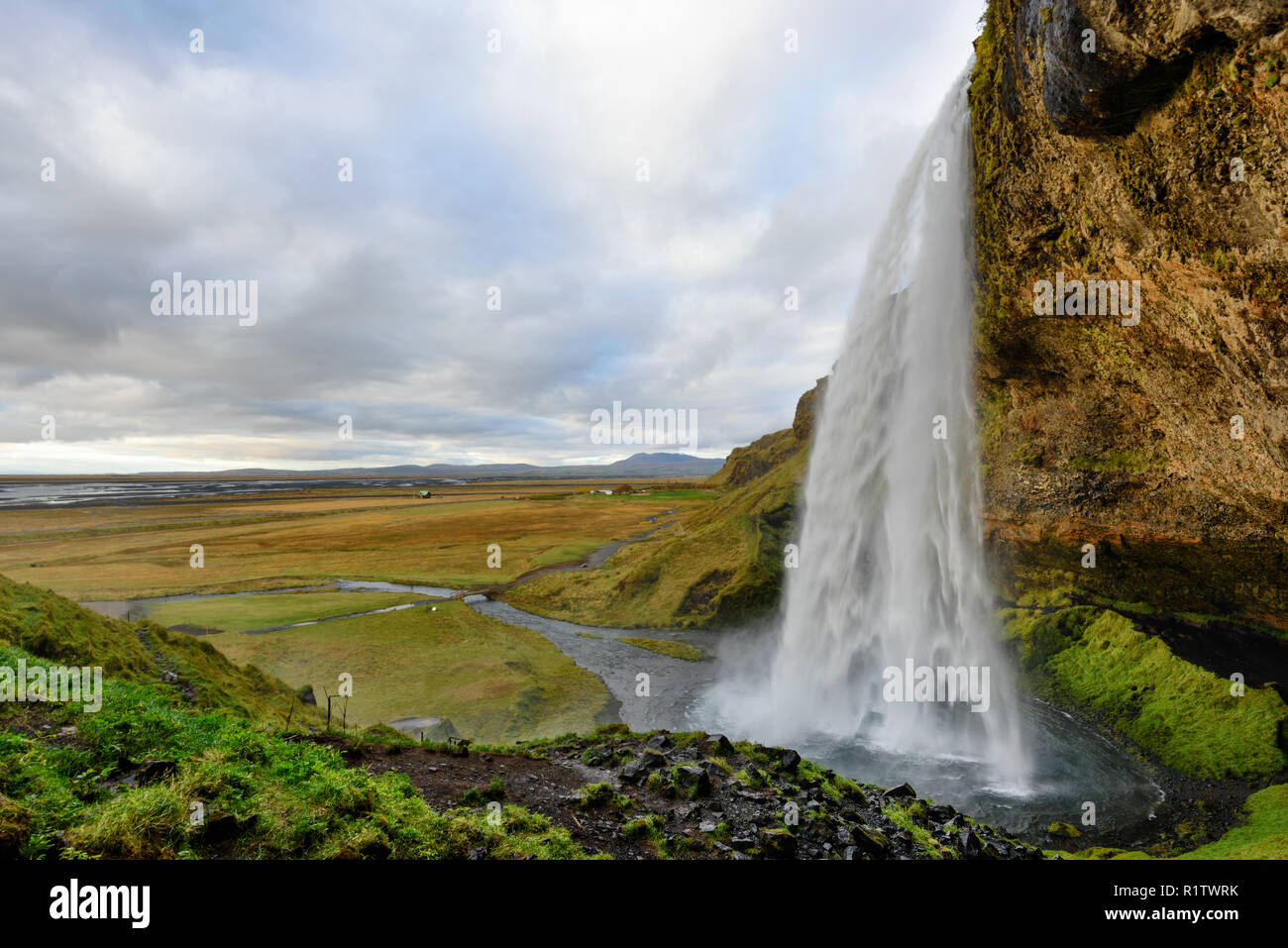 Majestic Seljalandsfoss, the most famous waterfall in Iceland. Sunset landscape. Beautiful tourist attraction in one of the main holiday destinations. Stock Photo