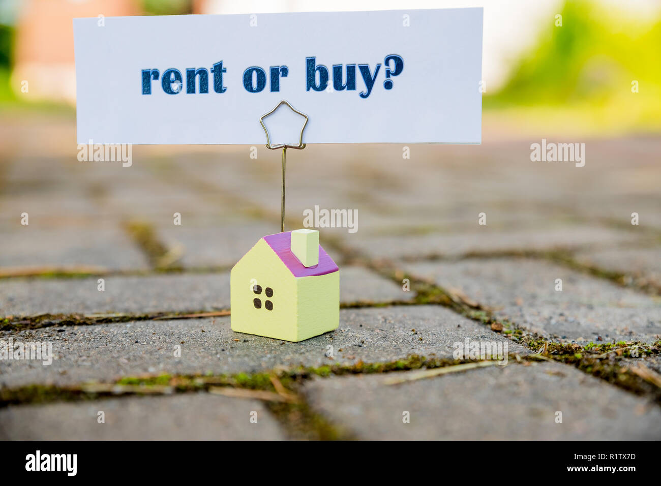 Buy or rent property concept. new House as wish .Text message Buy or rent with wooden small house. Business concept.difficult decision and choice.Copy space - Stock Image