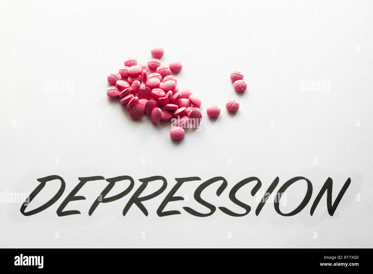 Pills above the word Depression - Stock Image