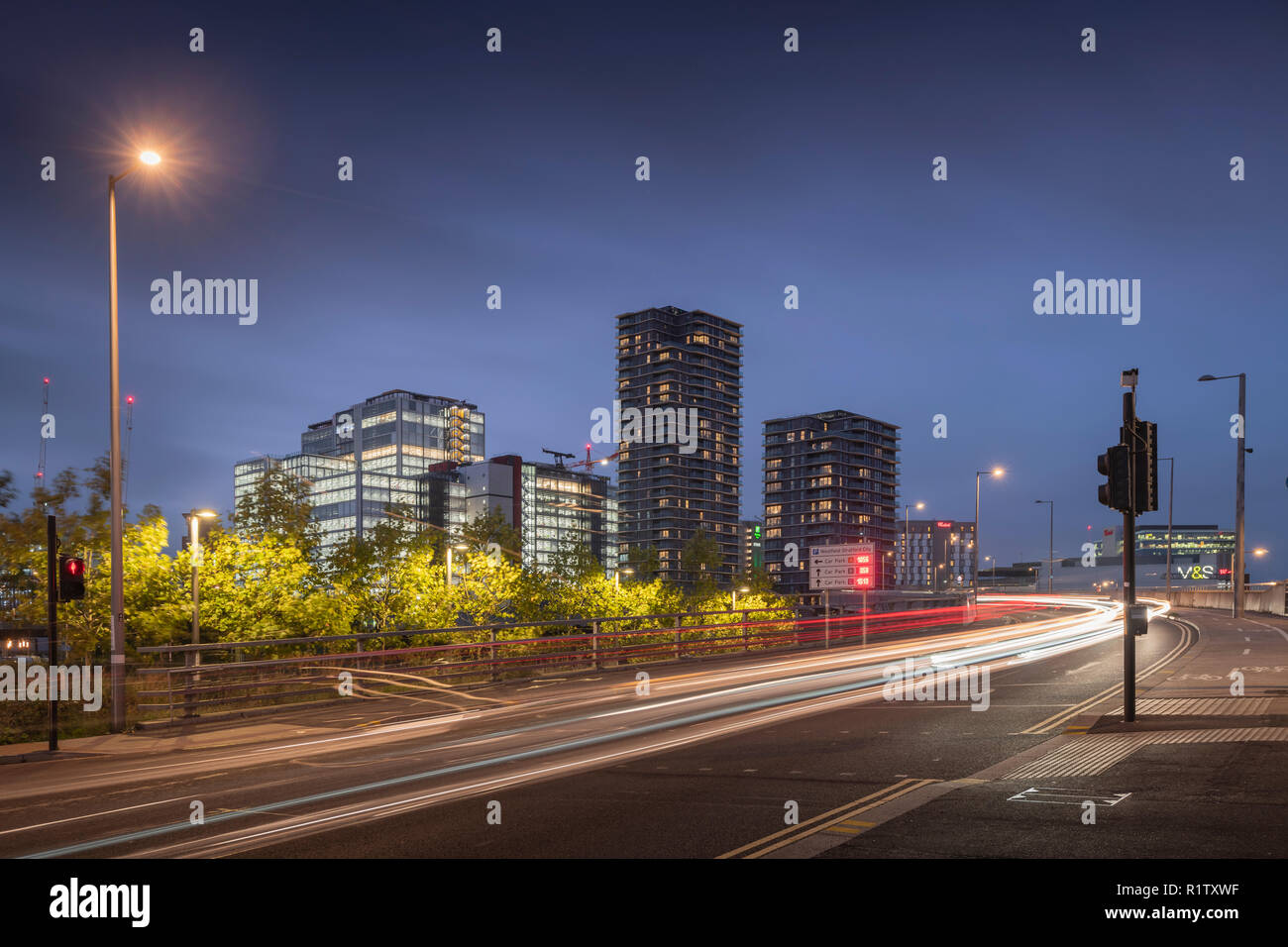 Glasshouse Gardens development and The International Quarter in Stratford, East London at night. - Stock Image