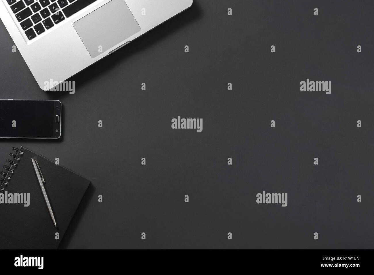 Laptop on black background copyspace textspace socialmedia - Stock Image