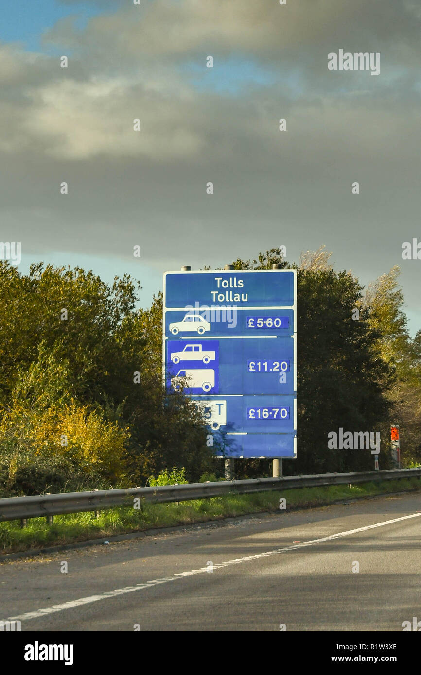 SECOND SEVERN CROSSING, WALES - NOVEMBER 2018: Sign at the side of the M4 motorway in Wales informing drivers of the toll charges for crossing the Sec - Stock Image