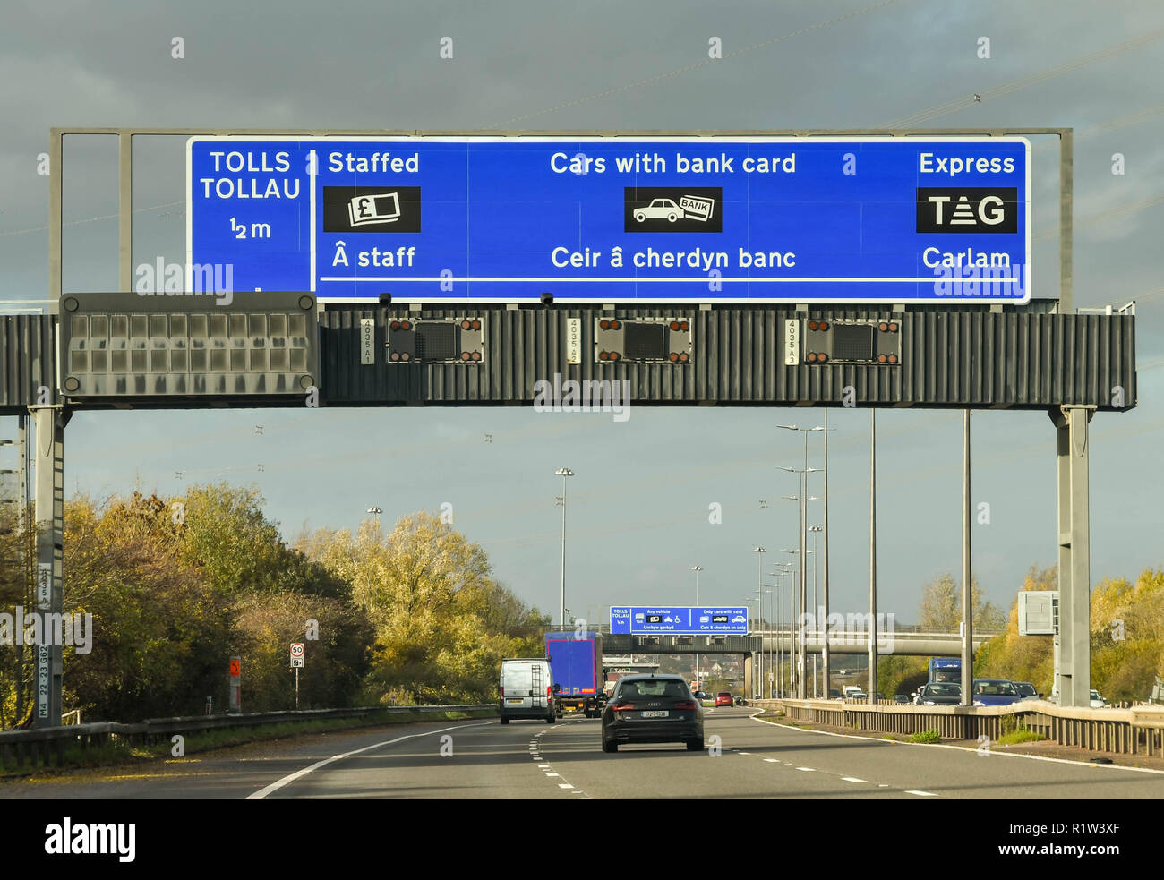 SECOND SEVERN CROSSING, WALES - NOVEMBER 2018: Gantry on the M4 motorway in Wales with information for drivers on paying the toll charges after using  - Stock Image