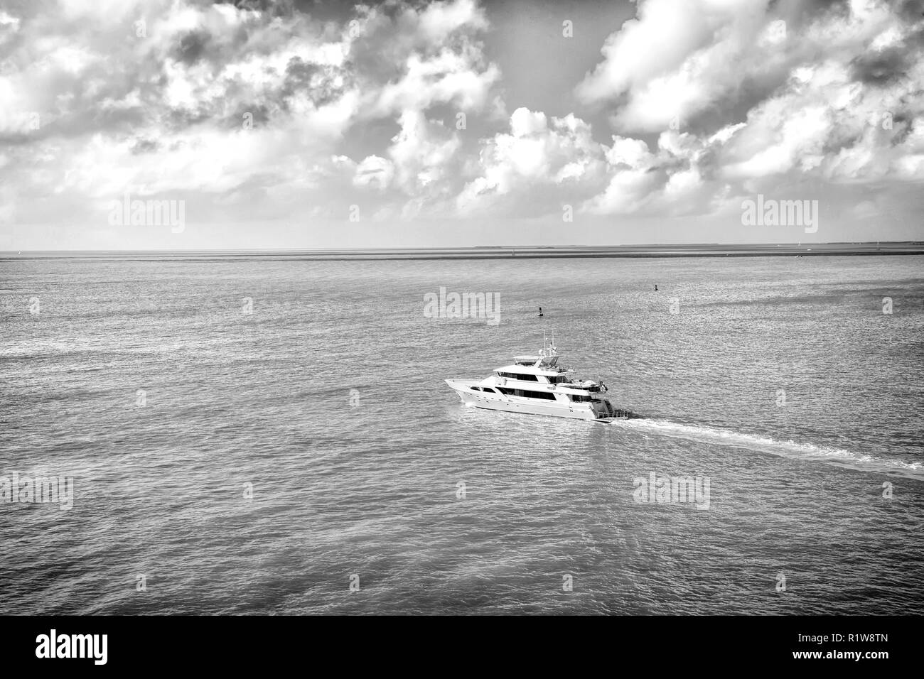 Adventure discovery journey. Yacht sail in turquoise sea on cloudy sky. Water transport, vessel, boat, transportation. Vacation wanderlust travelling. Luxury lifestyle concept. - Stock Image