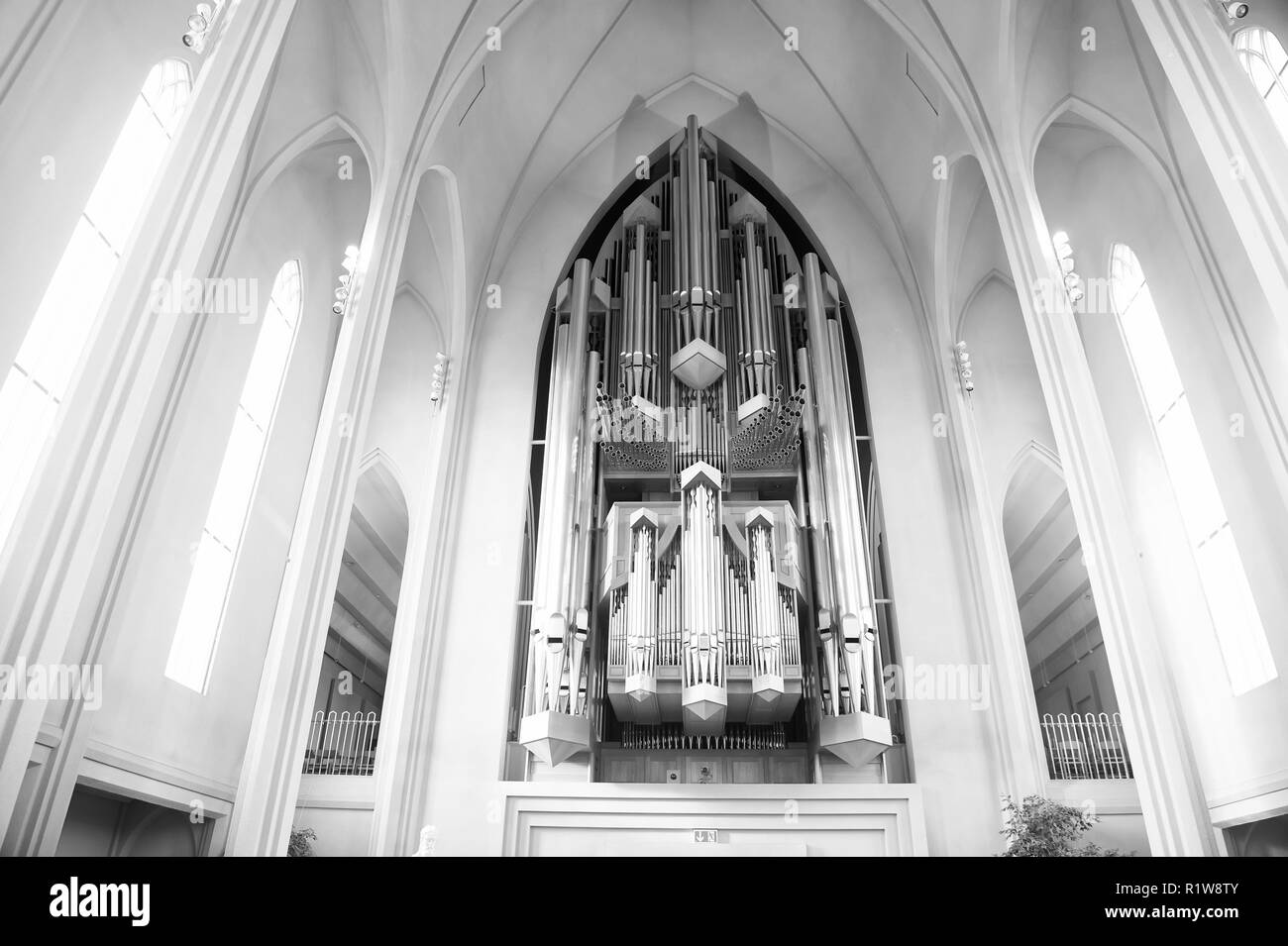 Reykjavik, Iceland - October 12, 2017: church organ flue pipes. Pipe organ in cathedral interior. Music and musical instrument. Religion or cult and christianity. Architecture and design. - Stock Image