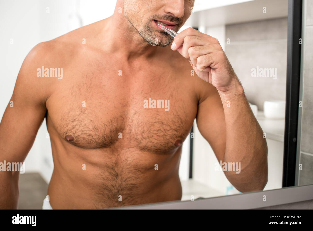 Cropped Image Of Adult Man With Muscular Torso Brushing Teeth And