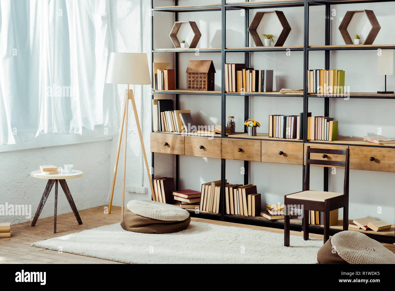 interior of living room with wooden furniture and books - Stock Image
