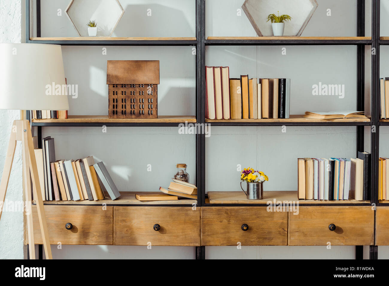 close up of wooden rack with books in living room - Stock Image