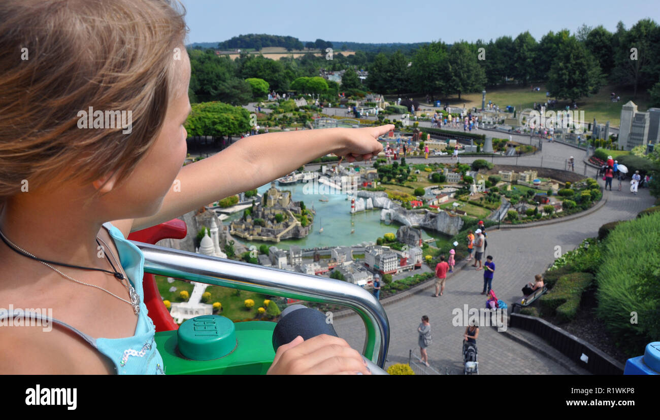 Editorial - LEGO miniland in Legoland Windsor theme park. Girl is pointing at her favorite building London Eye all made by bricks in Lego. - Stock Image