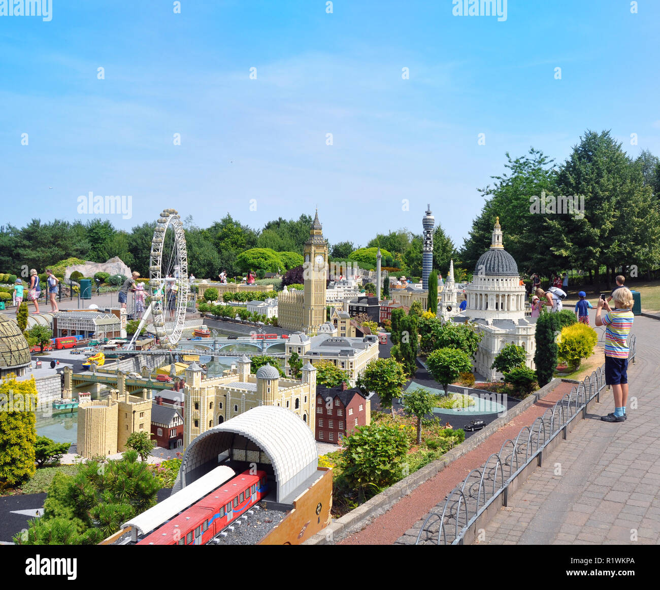 Editorial - LEGOLAND miniland in Windsor theme park. Wonderful landmarks built with bricks of lego. Boy photographing during his vacation. Stock Photo