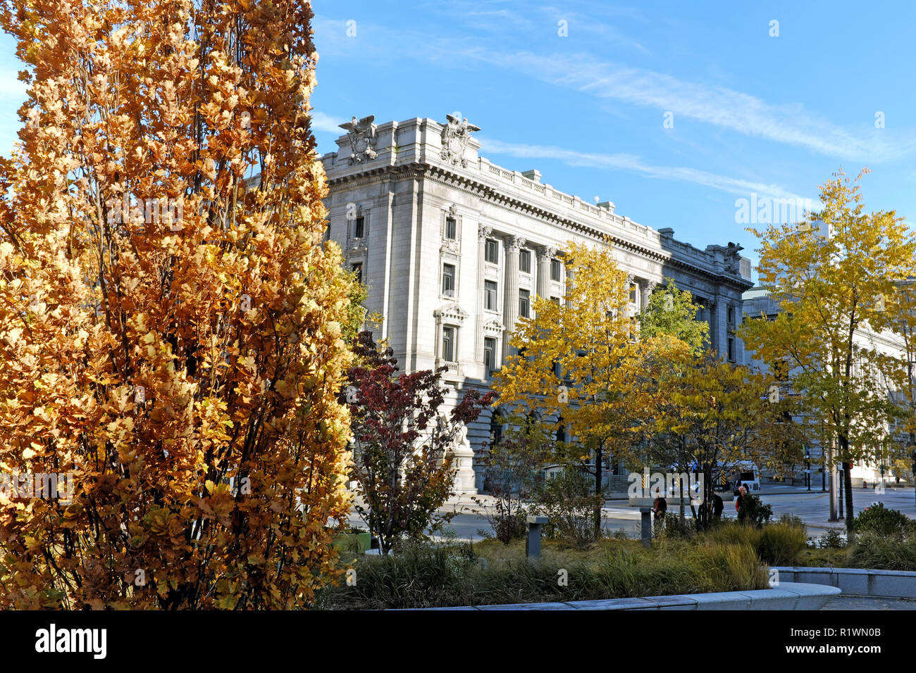 Viewed through the downtown Cleveland Public Square fall foliage, the southwest corner of the historic Metzenbaum U.S. Courthouse is viewed. - Stock Image