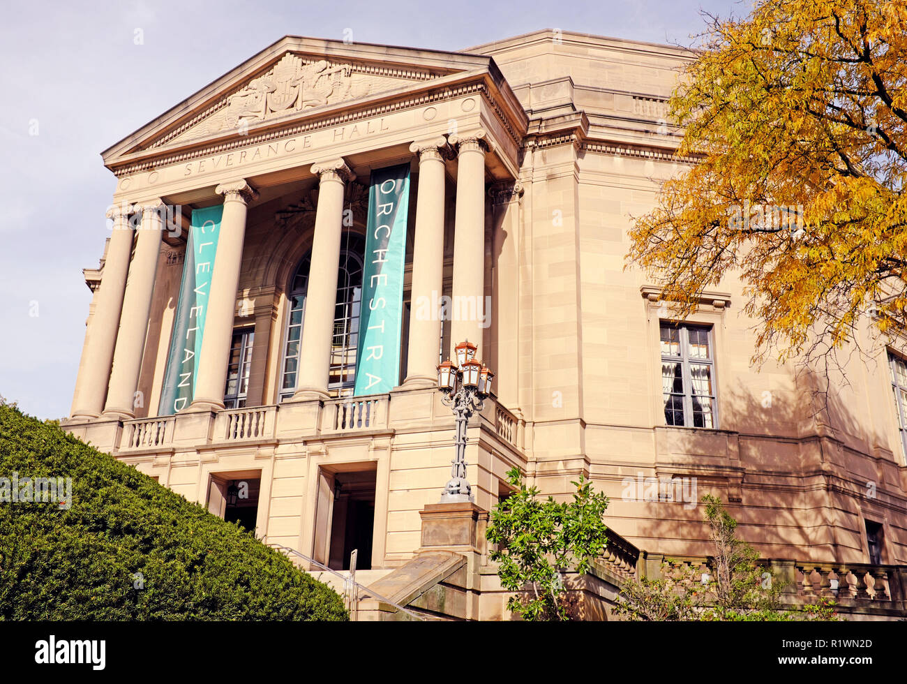 Severance Hall, home of the Cleveland Orchestra, in Cleveland, Ohio, USA with its classical exterior is complemented by the fall colored foliage. - Stock Image