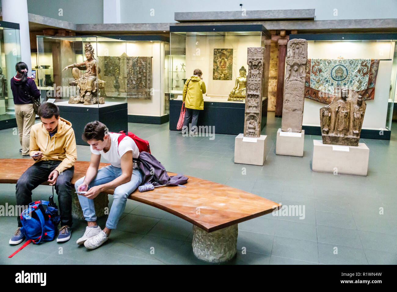 London England United Kingdom Great Britain Knightsbridge Victoria and & Albert Museum V&A V & Agalle inside interior Asia Collection boy teen using s - Stock Image