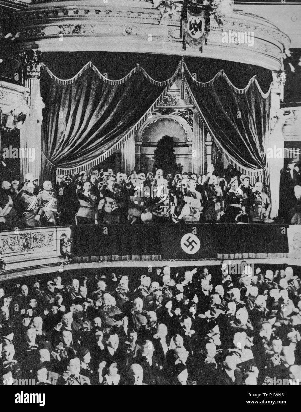 Hitler at Kroll Opera House, Berlin (seat of the Reichstag) March 16th 1935 - Memorial Day for fallen soldiers in previous war - His Nazi cabinet and followers are with him on the balcony giving a Nazi salute - Stock Image