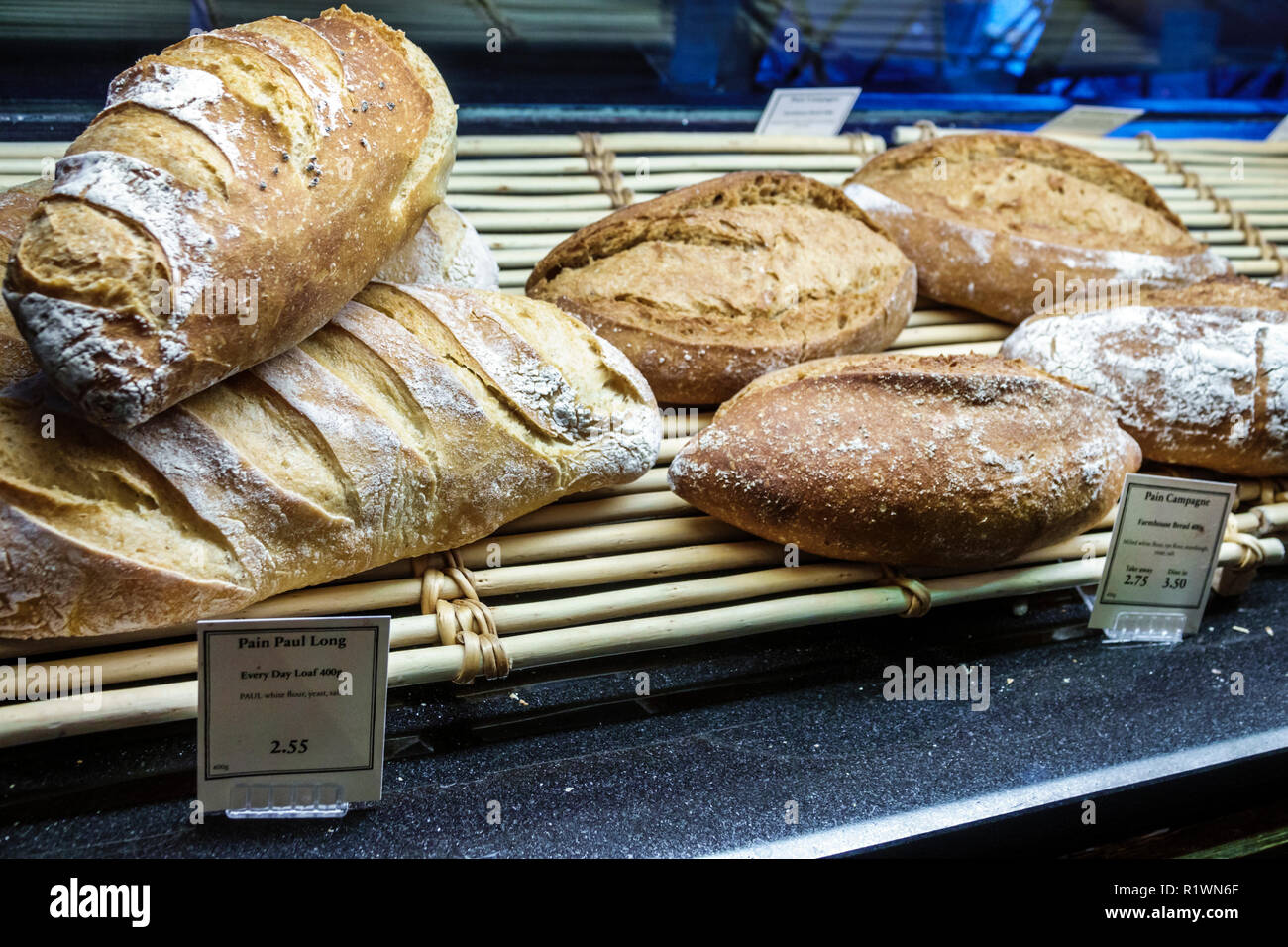 London England United Kingdom Great Britain South Kensington PAUL Bakery & Cafe loaf artisanal pain de campagne farmhouse bread display sale - Stock Image