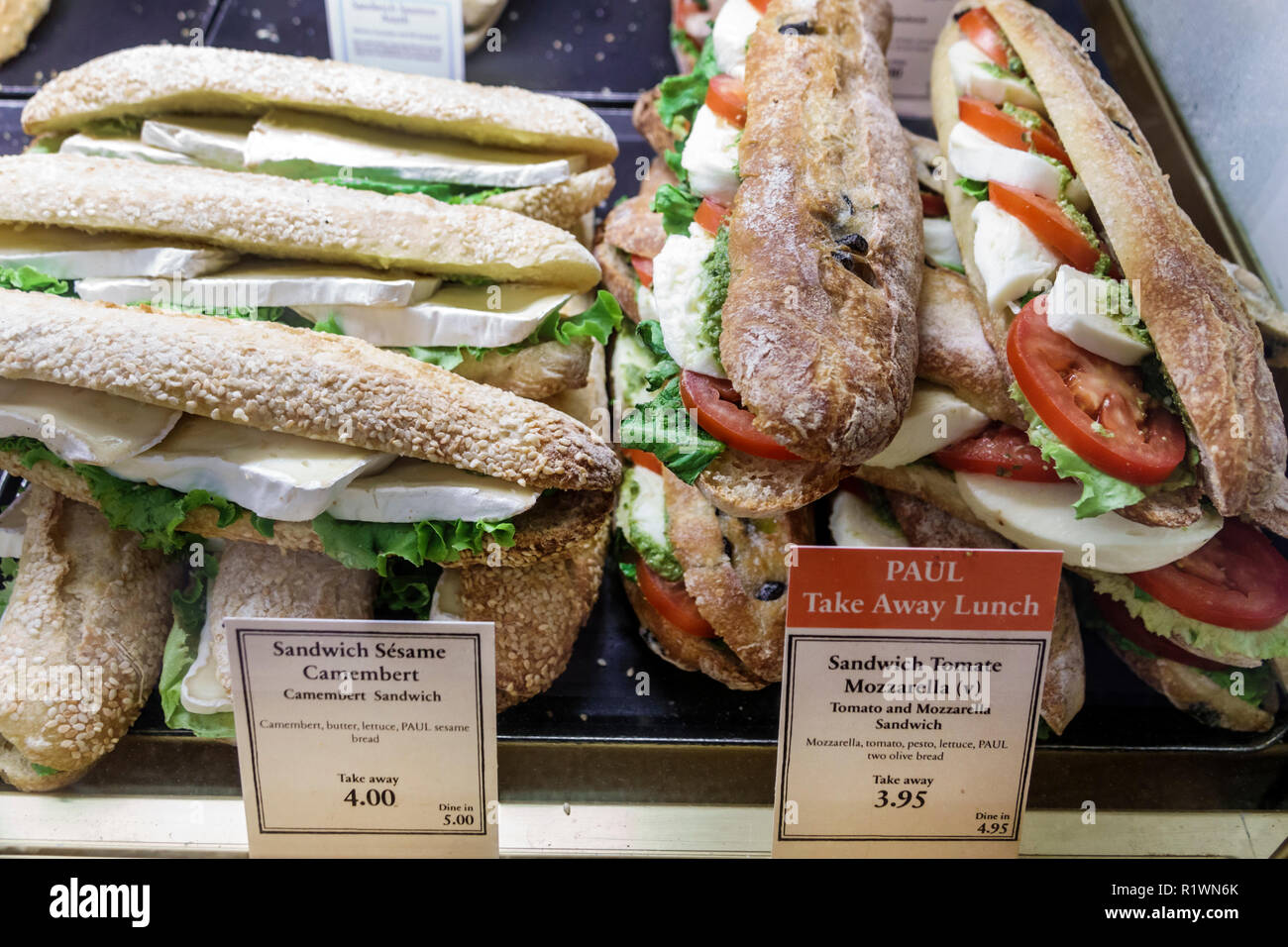 London England United Kingdom Great Britain South Kensington PAUL Bakery & Cafe artisanal take-away bread bagette cambembert cheese sandwich Caprese m - Stock Image