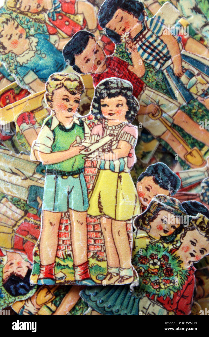 Old picture card paper boy and girl figures Stock Photo