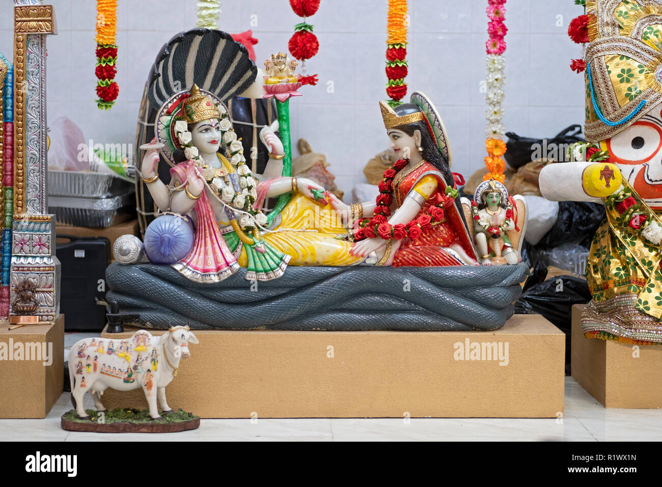Ornate statue of Vishnu (left) and Lakshmi on the altar of the Om Shakti Hindu temple in Woodside, Queens, New York. - Stock Image