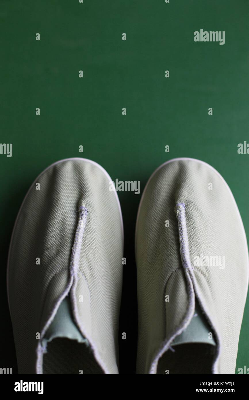 A pair of green canvas shoes for women made by Unstitched Utilities. - Stock Image