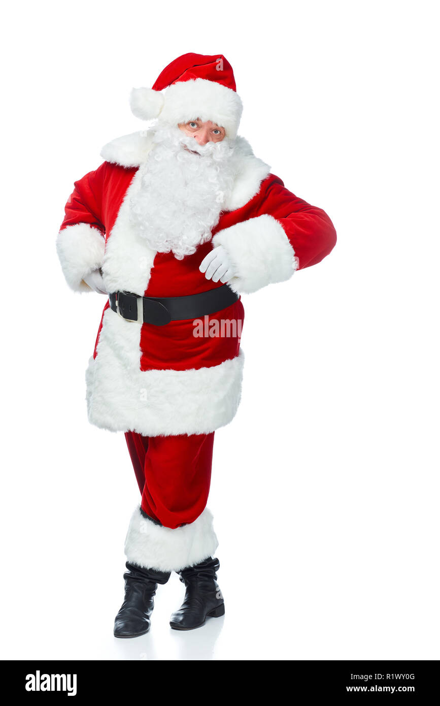 happy santa claus posing at christmastime isolated on white - Stock Image