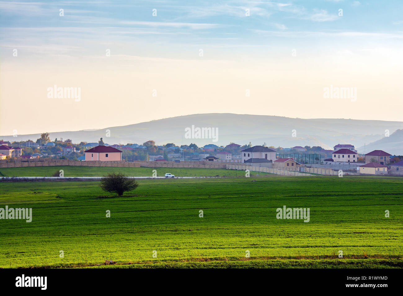 A small village in the foothills - Stock Image