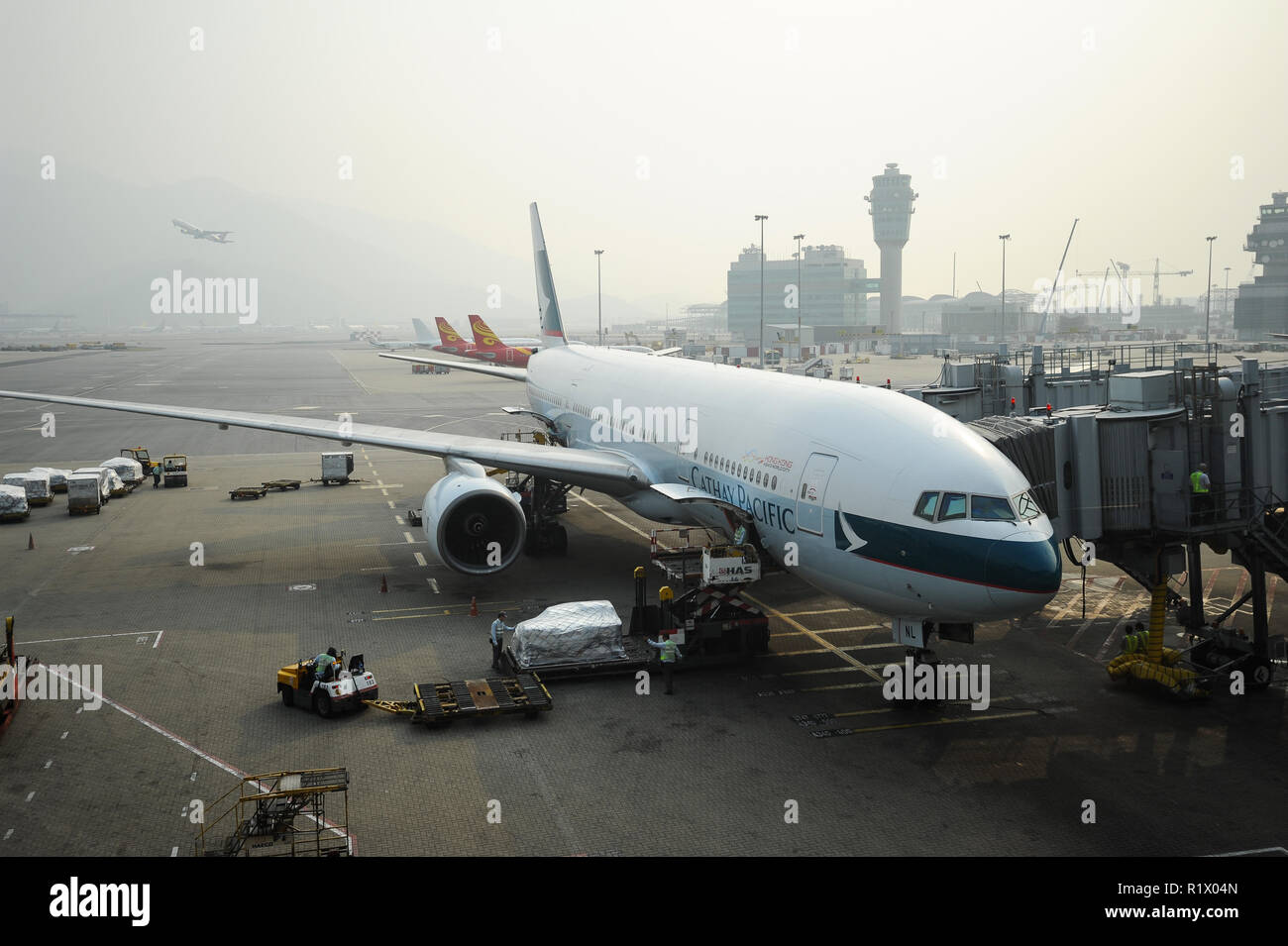 14.10.2014, Hong Kong, China, Asia - A Cathay Pacific passenger plane is docked at a gate at Hong Kong's International Airport Chek Lap Kok. Stock Photo