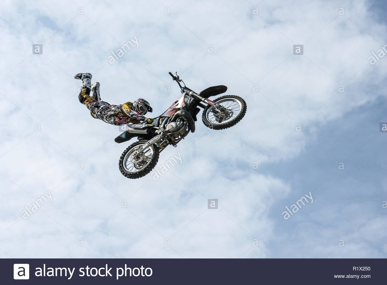 Man With Off Road Motorcycle Doing Tricks - Stock Image