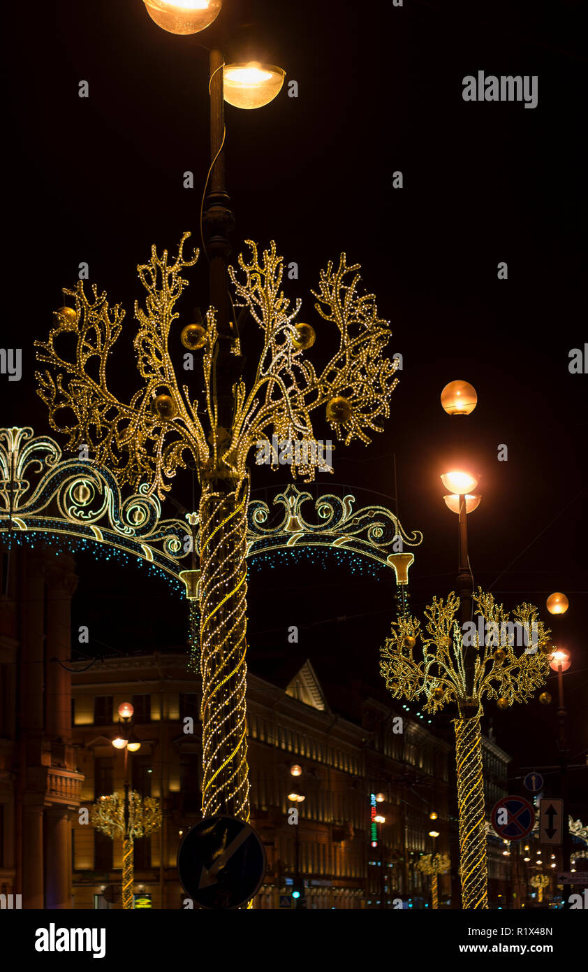 Night illumination with garlands and lanterns for Christmas holidays in the night city of St. Petersburg - Stock Image