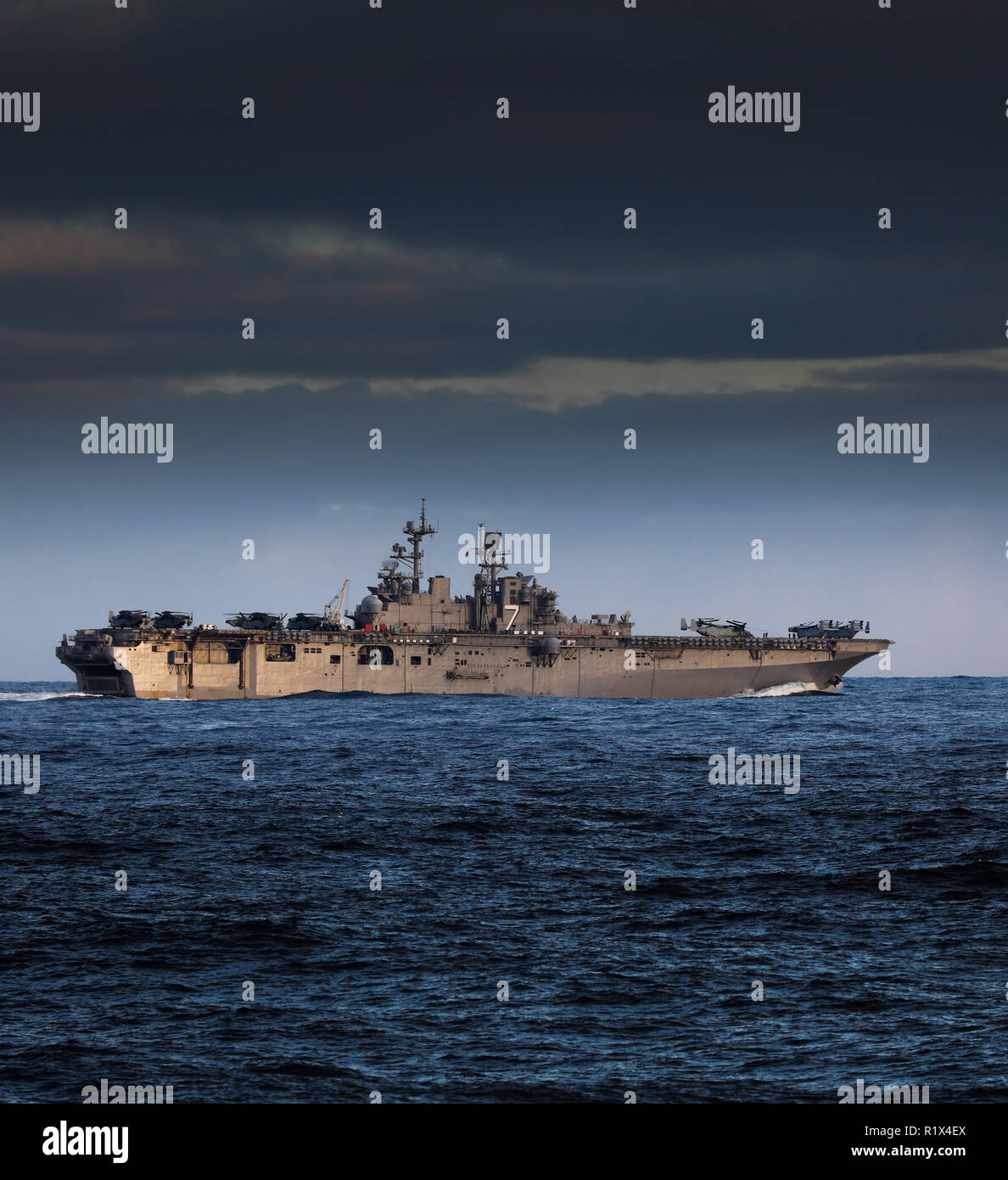 USS Iwo Jima assault carrier with embarked tiltrotpr V22 Ospreys - Stock Image